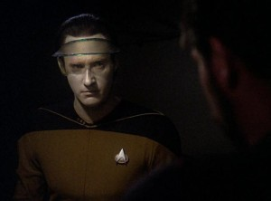 Data wearing a visor with a serious expression
